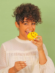 girl with white teeth and a donut