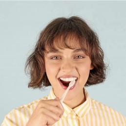 girl with white teeth brushing