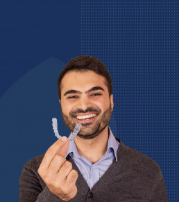 man with white teeth and invisible aligners